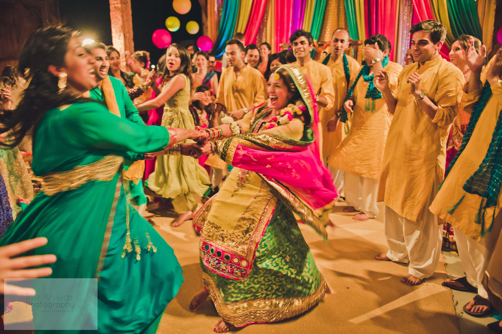 Mehndi Party Attire : Singing and dancing at a pakistani mehndi party rustic decor by
